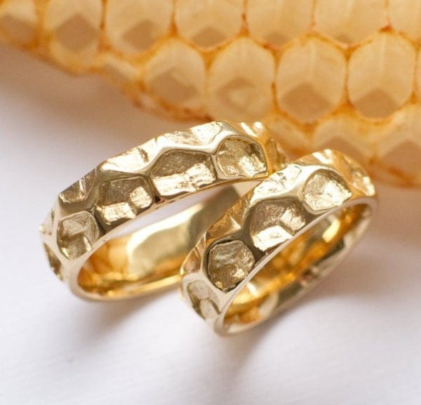 Pair of gold honeycomb pattern wedding bands